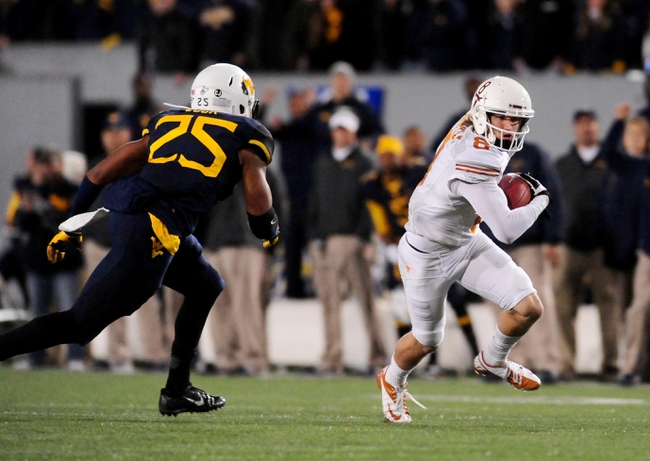 Nov 9, 2013; Morgantown, WV, USA; Texas Longhorns wide receiver Jaxon Shipley (8) runs with the ball in front of West Virginia Mountaineers safety Darwin Cook (25) at Milan Puskar Stadium. Mandatory Credit: Evan Habeeb-USA TODAY Sports