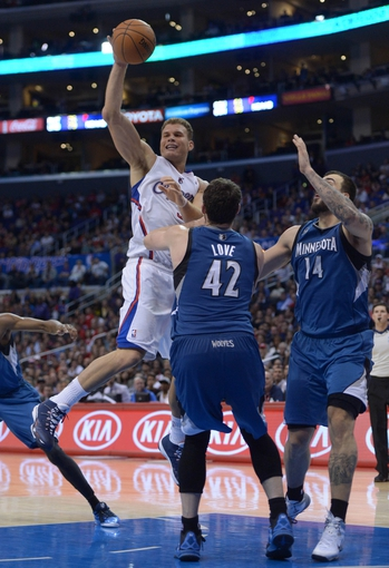 Nov 11, 2013; Los Angeles, CA, USA; Los Angeles Clippers forward Blake Griffin (32) is defended by Minnesota Timberwolves forward Kevin Love (42) and center Nikola Pekovic (14) at Staples Center. The Clippers defeated the Timberwolves 109-107. Mandatory Credit: Kirby Lee-USA TODAY Sports
