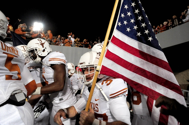 Nov 9, 2013; Morgantown, WV, USA; Texas Longhorns deep snapper Nate Boyer (37) carries a flag onto the field prior to the game against the West Virginia Mountaineers at Milan Puskar Stadium. Mandatory Credit: Evan Habeeb-USA TODAY Sports