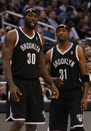 Nov 3, 2013; Orlando, FL, USA; Brooklyn Nets power forward Reggie Evans (30) and shooting guard Jason Terry (31) talk against the Orlando Magic during the second half at Amway Center. Mandatory Credit: Kim Klement-USA TODAY Sports