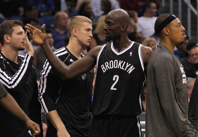 Nov 3, 2013; Orlando, FL, USA; Brooklyn Nets power forward Kevin Garnett (2) high fives teammates against the Orlando Magic during the second half at Amway Center. Mandatory Credit: Kim Klement-USA TODAY Sports
