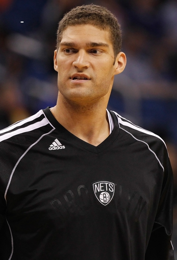 Nov 3, 2013; Orlando, FL, USA; Brooklyn Nets center Brook Lopez (11) against the Orlando Magic during the first quarter at Amway Center. Mandatory Credit: Kim Klement-USA TODAY Sports