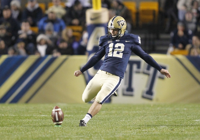 Nov 9, 2013; Pittsburgh, PA, USA; Pittsburgh Panthers kicker Chris Blewitt (12) kicks the ball off to the Notre Dame Fighting Irish during the second quarter against at Heinz Field. PITT won 28-21. Mandatory Credit: Charles LeClaire-USA TODAY Sports