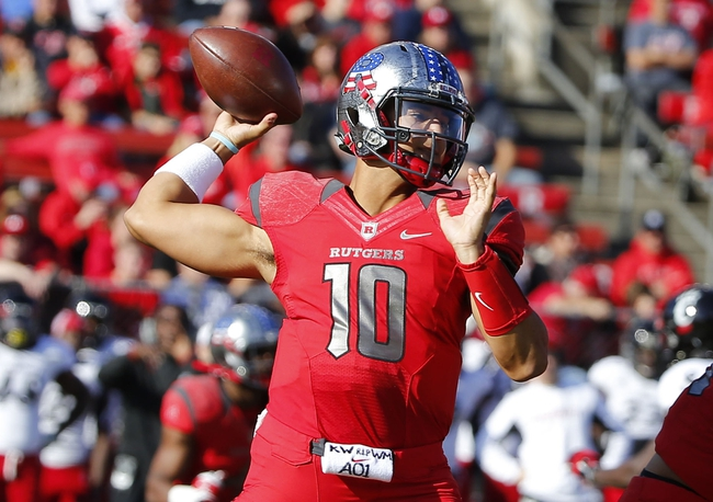 Nov 16, 2013; Piscataway, NJ, USA;  Rutgers Scarlet Knights quarterback Gary Nova (10) throws a pass against the Cincinnati Bearcats at High Points Solutions Stadium. Mandatory Credit: Jim O'Connor-USA TODAY Sports
