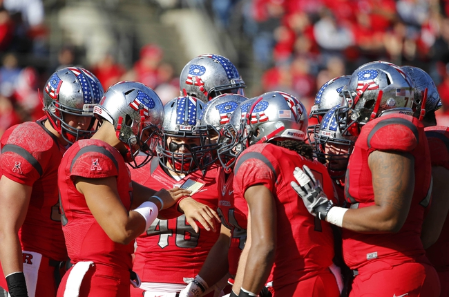 Nov 16, 2013; Piscataway, NJ, USA;  Rutgers Scarlet Knights huddle during the first half against the Cincinnati Bearcats at High Points Solutions Stadium. Mandatory Credit: Jim O'Connor-USA TODAY Sports