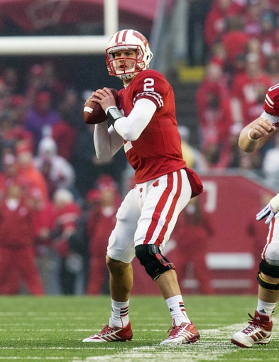 Nov 16, 2013; Madison, WI, USA; Wisconsin Badgers quarterback Joel Stave (2) drops back to pass during the second quarter against the Indiana Hoosiers at Camp Randall Stadium. Mandatory Credit: Jeff Hanisch-USA TODAY Sports