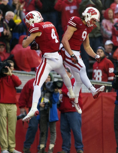 Nov 16, 2013; Madison, WI, USA; Wisconsin Badgers wide receivers Jared Abbrederis (4) and Jordan Fredrick (9) celebrate a touchdown during the second quarter against the Indiana Hoosiers at Camp Randall Stadium. Mandatory Credit: Jeff Hanisch-USA TODAY Sports