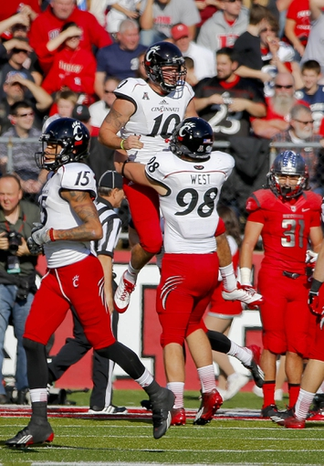 Nov 16, 2013; Piscataway, NJ, USA;  Cincinnati Bearcats fullback Jordan Luallen (10) celebrates touchdown against the Rutgers Scarlet Knights during the first half at High Points Solutions Stadium. Mandatory Credit: Jim O'Connor-USA TODAY Sports