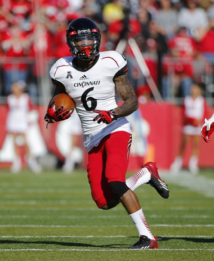 Nov 16, 2013; Piscataway, NJ, USA;  Cincinnati Bearcats wide receiver Anthony McClung (6) turns up field after pass reception during the first half against the Rutgers Scarlet Knights at High Points Solutions Stadium. Mandatory Credit: Jim O'Connor-USA TODAY Sports