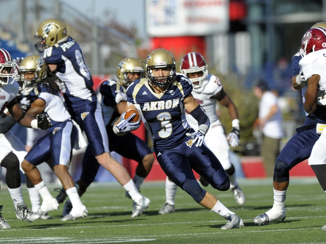 Nov 16, 2013; Foxborough, MA, USA; Akron Zips wide receiver L.T. Smith (3) runs the opening kickoff down the field during the first half against the Massachusetts Minutemen at Gillette Stadium. Mandatory Credit: Bob DeChiara-USA TODAY Sports