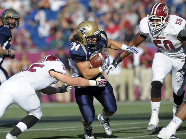 Nov 16, 2013; Foxborough, MA, USA; Akron Zips running back Conor Hundley (34) is tackled by Massachusetts Minutemen defensive back Joe Colton (25) during the first half at Gillette Stadium. Mandatory Credit: Bob DeChiara-USA TODAY Sports
