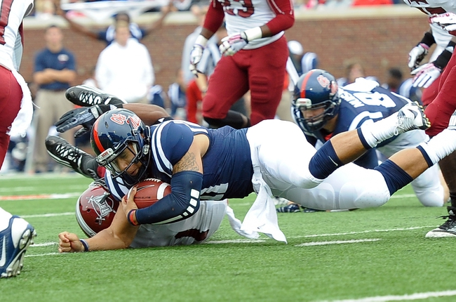 Nov 16, 2013; Oxford, MS, USA; Mississippi Rebels quarterback Barry Brunetti (11) is brought down by a Troy Trojans during the first half at Vaught-Hemingway Stadium. Mandatory Credit: Justin Ford-USA TODAY Sports