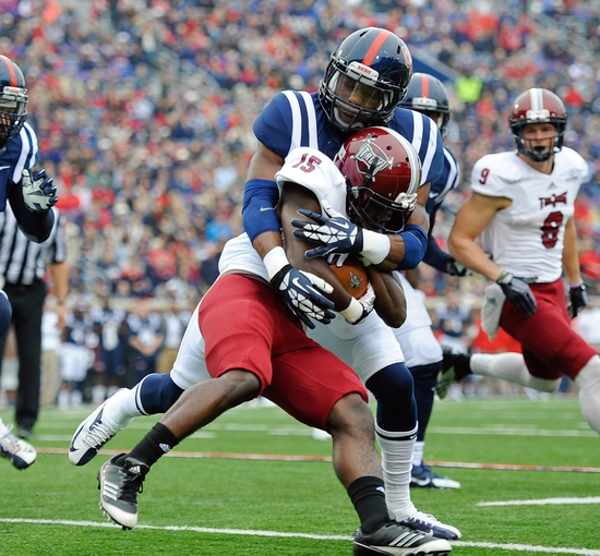 Nov 16, 2013; Oxford, MS, USA; Troy Trojans running back Khary Franklin (15) is tackled by a Mississippi Rebels during the first half at Vaught-Hemingway Stadium. Mandatory Credit: Justin Ford-USA TODAY Sports