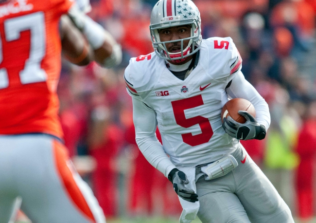 Nov 16, 2013; Champaign, IL, USA;  Ohio State Buckeyes quarterback Braxton Miller (5) runs the ball during the second quarter against the Illinois Fighting Illini at Memorial Stadium. Mandatory Credit: Bradley Leeb-USA TODAY Sports