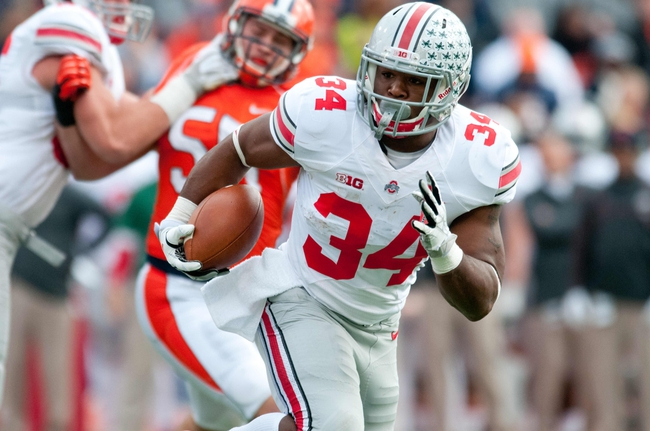 Nov 16, 2013; Champaign, IL, USA;  Ohio State Buckeyes running back Carlos Hyde (34) runs for a touchdown during the second quarter against the Illinois Fighting Illini at Memorial Stadium. Mandatory Credit: Bradley Leeb-USA TODAY Sports