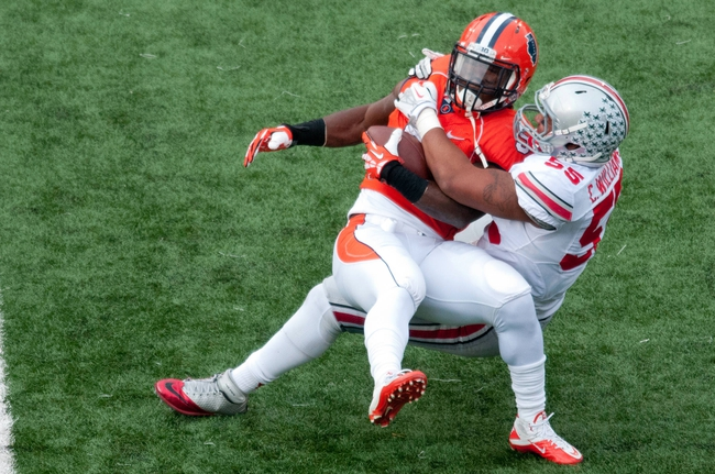 Nov 16, 2013; Champaign, IL, USA;  Ohio State Buckeyes linebacker Camren Williams (55) tackles Illinois Fighting Illini running back Donovonn Young (5) during the second quarter at Memorial Stadium. Mandatory Credit: Bradley Leeb-USA TODAY Sports