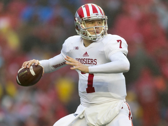 Nov 16, 2013; Madison, WI, USA; Indiana Hoosiers quarterback Nate Sudfeld (7) throws a pass during the third quarter against the Wisconsin Badgers at Camp Randall Stadium. Wisconsin won 51-3.  Mandatory Credit: Jeff Hanisch-USA TODAY Sports