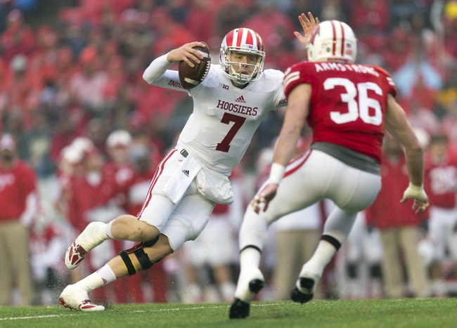 Nov 16, 2013; Madison, WI, USA; Indiana Hoosiers quarterback Nate Sudfeld (7) scrambles with the football as Wisconsin Badgers linebacker Ethan Armstrong (36) defends during the third quarter at Camp Randall Stadium. Wisconsin won 51-3.  Mandatory Credit: Jeff Hanisch-USA TODAY Sports