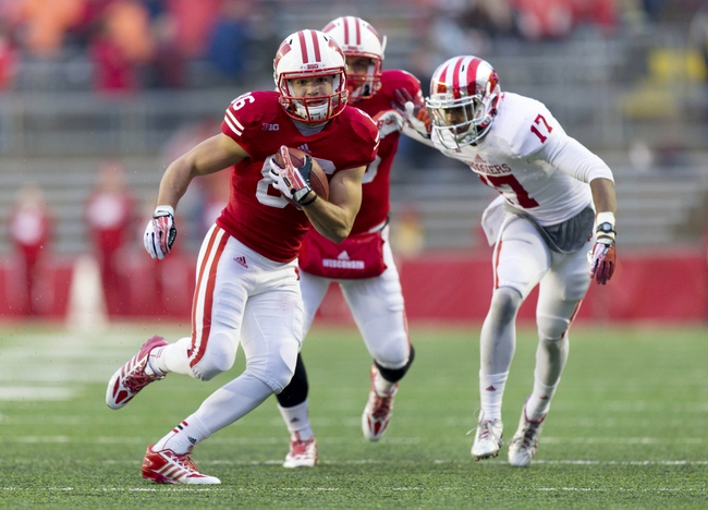 Nov 16, 2013; Madison, WI, USA; Wisconsin Badgers wide receiver Alex Erickson (86) rushes with the football after catching a pass as Indiana Hoosiers cornerback Michael Hunter (17) chases from behind during the fourth quarter at Camp Randall Stadium. Wisconsin won 51-3.  Mandatory Credit: Jeff Hanisch-USA TODAY Sports
