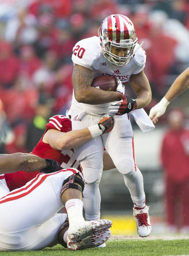 Nov 16, 2013; Madison, WI, USA; Indiana Hoosiers running back D'Angelo Roberts (20) carries the football during the fourth quarter against the Wisconsin Badgers at Camp Randall Stadium. Mandatory Credit: Jeff Hanisch-USA TODAY Sports