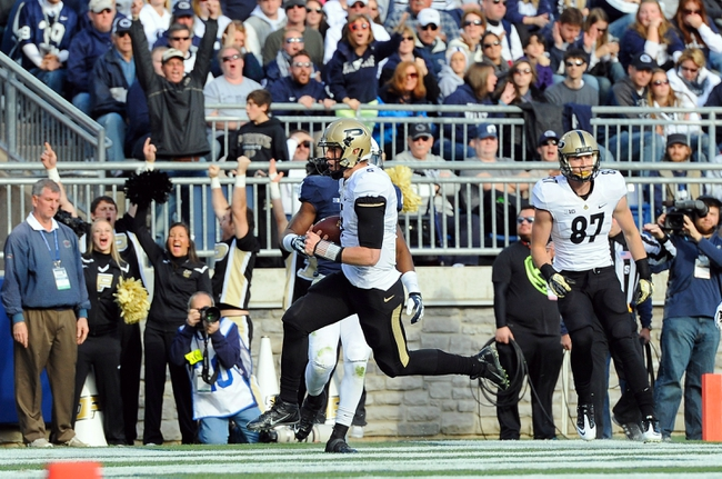 Nov 16, 2013; University Park, PA, USA; Purdue Boilermakers quarterback Danny Etling (5) runs into the end zone for a touchdown against the Penn State Nittany Lions during the third quarter at Beaver Stadium.  Penn State defeated Purdue  45-21.  Mandatory Credit: Rich Barnes-USA TODAY Sports