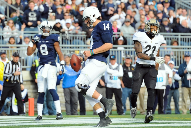 Nov 16, 2013; University Park, PA, USA; Penn State Nittany Lions quarterback Christian Hackenberg (14) runs into the end zone for a touchdown in front of Purdue Boilermakers cornerback Ricardo Allen (21) during the fourth quarter at Beaver Stadium.  Penn State defeated Purdue  45-21.  Mandatory Credit: Rich Barnes-USA TODAY Sports