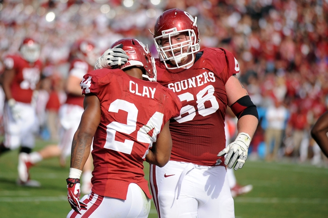 Nov 16, 2013; Norman, OK, USA; Oklahoma Sooners running back Brennan Clay (24) celebrates a touchdown with offensive lineman Bronson Irwin (68) against the Iowa State Cyclones in the second half at Gaylord Family - Oklahoma Memorial Stadium. Mandatory Credit: Mark D. Smith-USA TODAY Sports
