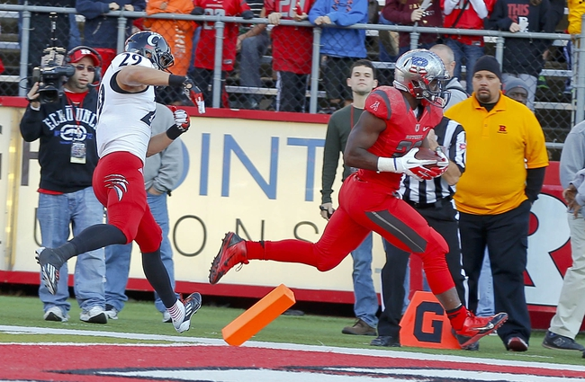 Nov 16, 2013; Piscataway, NJ, USA;  Rutgers Scarlet Knights running back Savon Huggins (28) scores touchdown Cincinnati Bearcats during the fourth quarter at High Points Solutions Stadium. Cincinnati Bearcats defeat the Rutgers Scarlet Knights 52-17. Mandatory Credit: Jim O'Connor-USA TODAY Sports