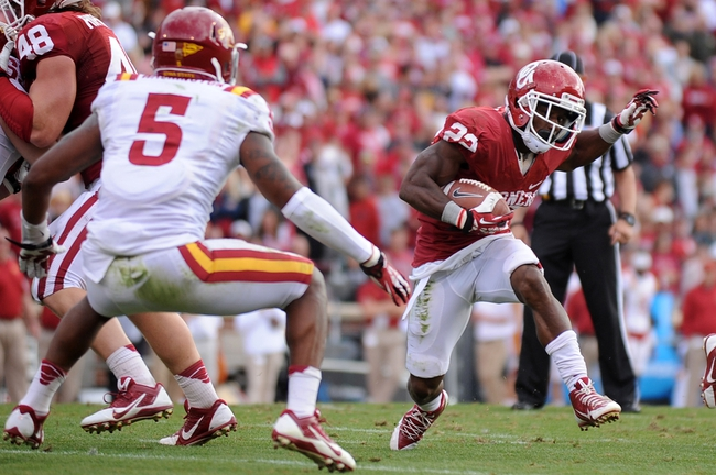Nov 16, 2013; Norman, OK, USA; Oklahoma Sooners running back Roy Finch (22) runs the ball against Iowa State Cyclones defensive back Jacques Washington (5) in the second half at Gaylord Family - Oklahoma Memorial Stadium. Mandatory Credit: Mark D. Smith-USA TODAY Sports