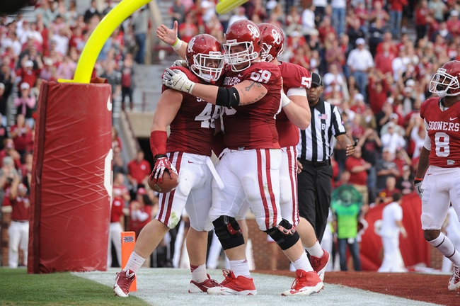 Nov 16, 2013; Norman, OK, USA; Oklahoma Sooners fullback Aaron Ripkowski (48) celebrates with offensive lineman Bronson Irwin (68) and Sooners offensive lineman Austin Woods (50) in the second half at Gaylord Family - Oklahoma Memorial Stadium. Mandatory Credit: Mark D. Smith-USA TODAY Sports