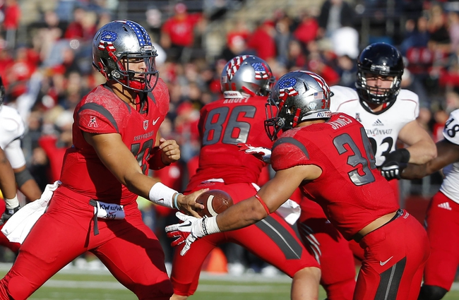 Nov 16, 2013; Piscataway, NJ, USA;  Rutgers Scarlet Knights quarterback Gary Nova (10) hands off to running back Paul James (34) during the second half against the Cincinnati Bearcats at High Points Solutions Stadium. Cincinnati Bearcats defeat the Rutgers Scarlet Knights 52-17. Mandatory Credit: Jim O'Connor-USA TODAY Sports