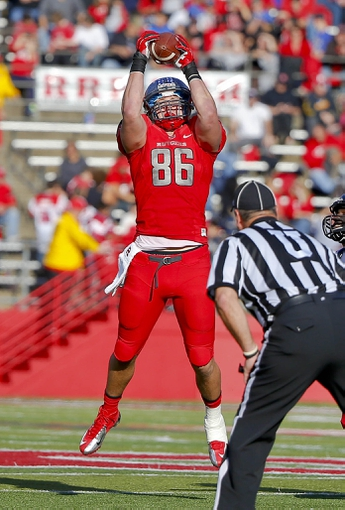Nov 16, 2013; Piscataway, NJ, USA;  Rutgers Scarlet Knights tight end Tyler Kroft (86) makes a reception against the Cincinnati Bearcats during the second half at High Points Solutions Stadium. Cincinnati Bearcats defeat the Rutgers Scarlet Knights 52-17. Mandatory Credit: Jim O'Connor-USA TODAY Sports