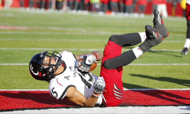 Nov 16, 2013; Piscataway, NJ, USA;  Cincinnati Bearcats wide receiver Chris Moore (15) scores touchdown against the Rutgers Scarlet Knights during the second half at High Points Solutions Stadium. Cincinnati Bearcats defeat the Rutgers Scarlet Knights 52-17. Mandatory Credit: Jim O'Connor-USA TODAY Sports