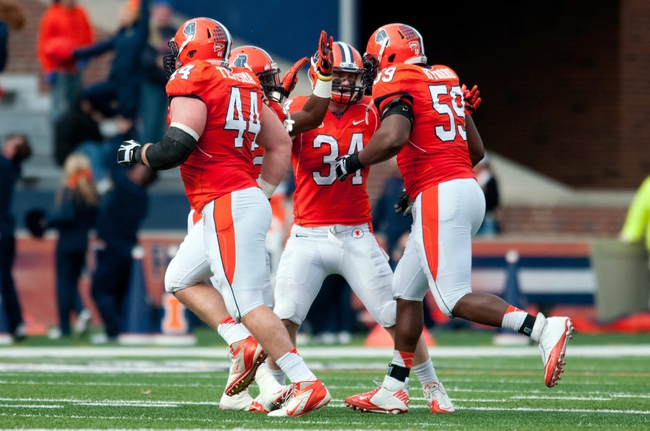 Nov 16, 2013; Champaign, IL, USA;  Illinois Fighting Illini players react after Illinois Fighting Illini defensive lineman Tim Kynard (59) recovers a fumble during the third quarter against the Ohio State Buckeyes at Memorial Stadium. Mandatory Credit: Bradley Leeb-USA TODAY Sports
