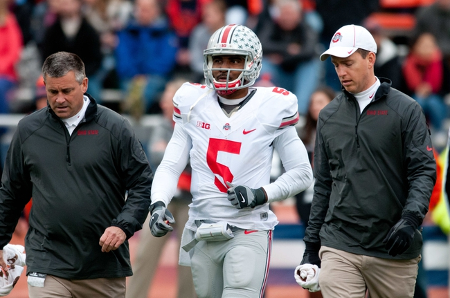 Nov 16, 2013; Champaign, IL, USA;  Ohio State Buckeyes quarterback Braxton Miller (5) walks off the field after being attended to during the third quarter against the Illinois Fighting Illini at Memorial Stadium. Mandatory Credit: Bradley Leeb-USA TODAY Sports
