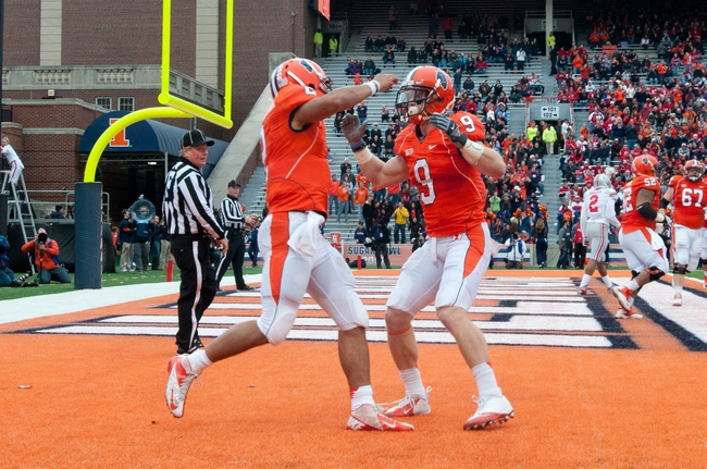 Nov 16, 2013; Champaign, IL, USA;  Illinois Fighting Illini wide receiver Steve Hull (9) celebrates with quarterback Nathan Scheelhaase (2) after Scheelhaase's touchdown during the fourth quarter against the Ohio State Buckeyes at Memorial Stadium. Mandatory Credit: Bradley Leeb-USA TODAY Sports