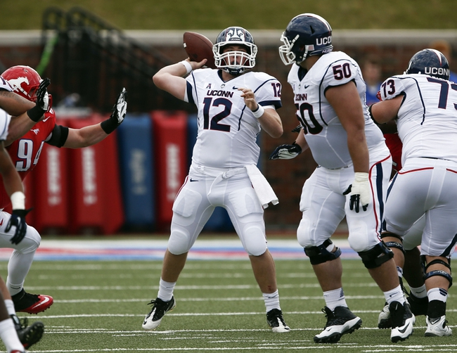 Nov 16, 2013; Dallas, TX, USA; Connecticut Huskies quarterback Casey Cochran (12) sets to pass against the Southern Methodist Mustangs during the first half on an NCAA football game at Gerald J. Ford Stadium. Mandatory Credit: Jim Cowsert-USA TODAY Sports