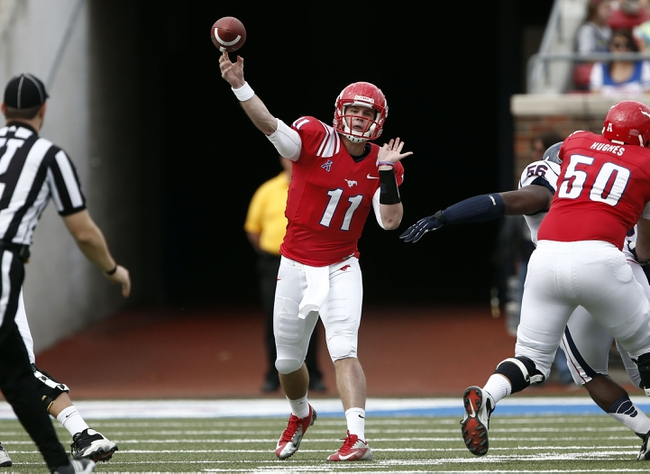 Nov 16, 2013; Dallas, TX, USA; Southern Methodist Mustangs quarterback Garrett Gilbert (11) throws a pass against the Connecticut Huskies during the first half on an NCAA football game at Gerald J. Ford Stadium. Mandatory Credit: Jim Cowsert-USA TODAY Sports
