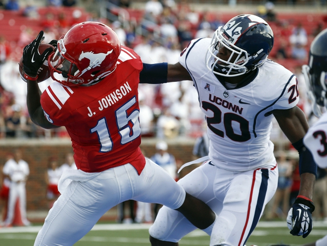 Nov 16, 2013; Dallas, TX, USA; Southern Methodist Mustangs wide receiver Jeremy Johnson (15) catches a touchdown pass in front of Connecticut Huskies safety Obi Melifonwu (20) during the first half on an NCAA football game at Gerald J. Ford Stadium. Mandatory Credit: Jim Cowsert-USA TODAY Sports