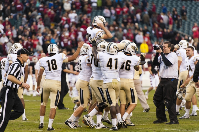 Nov 16, 2013; Philadelphia, PA, USA; UCF Knights players lift kicker Shawn Moffitt (83)  in the air after he kicked the game winning field goal as time expired during the fourth quarter against the Temple Owls at Lincoln Financial Field. UCF defeated Temple 39-36. Mandatory Credit: Howard Smith-USA TODAY Sports