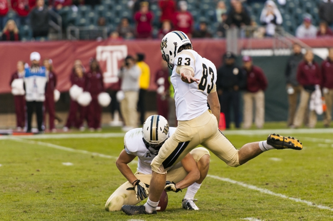 Nov 16, 2013; Philadelphia, PA, USA; UCF Knights kicker Shawn Moffitt (83) kicks the game winning field goal as time expires in the fourth quarter against the Temple Owls at Lincoln Financial Field. UCF defeated Temple 39-36. Mandatory Credit: Howard Smith-USA TODAY Sports