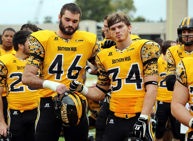 Nov 16, 2013; Hattiesburg, MS, USA; Southern Miss defensive lineman Wil Freeman (46) and  defensive back Evan Osborne (34) stand of the field against the Florida Atlantic Owls at M.M. Roberts Stadium. Florida Atlantic won 41-7. Mandatory Credit: Chuck Cook-USA TODAY Sports