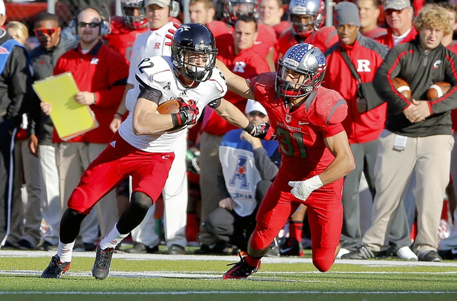 Nov 16, 2013; Piscataway, NJ, USA;  Rutgers Scarlet Knights defensive back Anthony Cioffi (31) brings down Cincinnati Bearcats wide receiver Max Morrison (82) after pass reception during the second half at High Points Solutions Stadium. Cincinnati Bearcats defeat the Rutgers Scarlet Knights 52-17. Mandatory Credit: Jim O'Connor-USA TODAY Sports