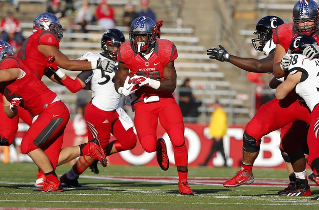 Nov 16, 2013; Piscataway, NJ, USA;  Rutgers Scarlet Knights running back Savon Huggins (28) breaks off big run during the second half against the Cincinnati Bearcats at High Points Solutions Stadium. Cincinnati Bearcats defeat the Rutgers Scarlet Knights 52-17. Mandatory Credit: Jim O'Connor-USA TODAY Sports