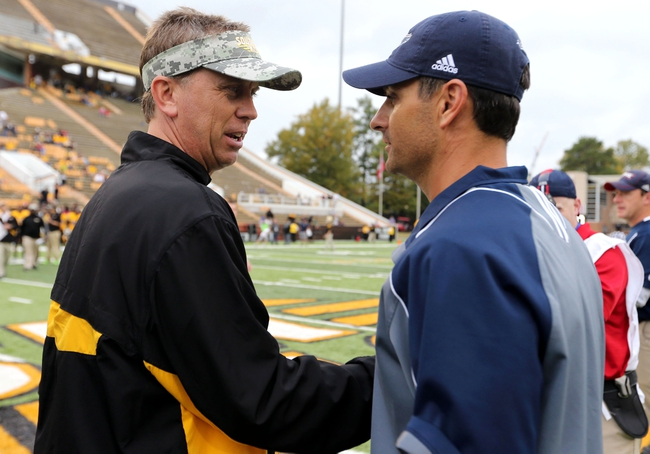 Nov 16, 2013; Hattiesburg, MS, USA; Southern Miss Golden Eagles head coach Todd Monken (l) speaks to Florida Atlantic Owls head coach Brian Wright (r) after the game at M.M. Roberts Stadium. Florida Atlantic won 41-7. Mandatory Credit: Chuck Cook-USA TODAY Sports