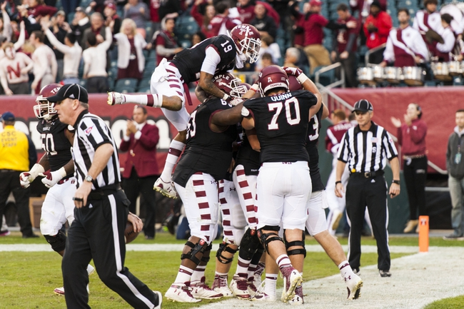 Nov 16, 2013; Philadelphia, PA, USA; Temple Owls tight end Chris Parthemore (83) celebrates scoring a touchdown with teammates during the fourth quarter against the UCF Knights at Lincoln Financial Field. UCF defeated Temple 39-36. Mandatory Credit: Howard Smith-USA TODAY Sports