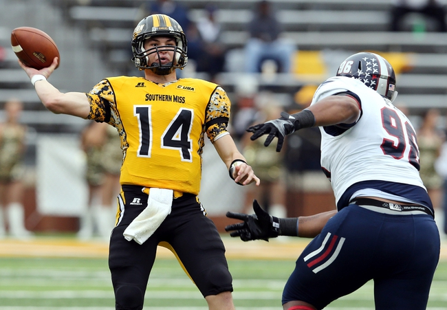 Nov 16, 2013; Hattiesburg, MS, USA; Southern Miss Golden Eagles quarterback Nick Mullens (14) throws the ball in front of Florida Atlantic Owls defensive tackle Lance Burlingame (96) during the second half at M.M. Roberts Stadium. Florida Atlantic won 41-7. Mandatory Credit: Chuck Cook-USA TODAY Sports