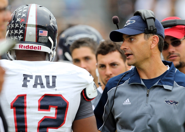 Nov 16, 2013; Hattiesburg, MS, USA; Florida Atlantic Owls head coach Brian Wright talks to quarterback Jaquez Johnson (12) against the Southern Miss Golden Eagles during the second half at M.M. Roberts Stadium. Florida Atlantic won 41-7. Mandatory Credit: Chuck Cook-USA TODAY Sports