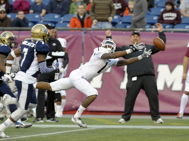 Nov 16, 2013; Foxborough, MA, USA; Massachusetts Minutemen wide receiver Tajae Sharpe (1) stretches to try and make a catch during the second half against the Akron Zips at Gillette Stadium. Mandatory Credit: Bob DeChiara-USA TODAY Sports