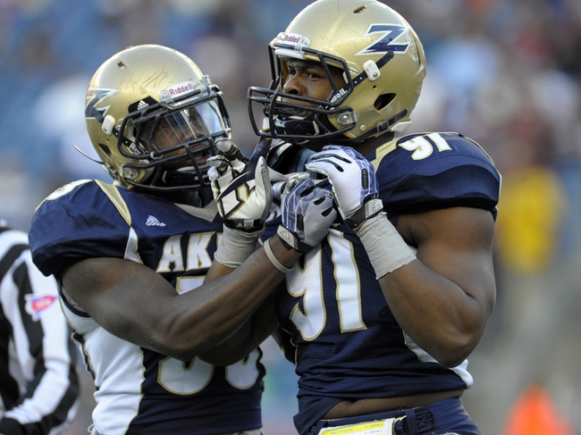 Nov 16, 2013; Foxborough, MA, USA; Akron Zips linebacker Jatavis Brown (53) grabs Akron Zips defensive lineman Albert Presley (91) after being called for a personal foul penalty during the second half against the Massachusetts Minutemen at Gillette Stadium. Mandatory Credit: Bob DeChiara-USA TODAY Sports